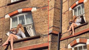 Karantinadan sıkılan Serel Yereli, pencereye oturdu